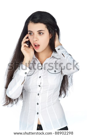beautiful young brunette girl with thick hair on the phone, on a white background