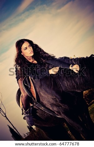 beautiful young brunette on a horseback