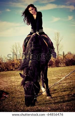 beautiful young brunette on a horseback