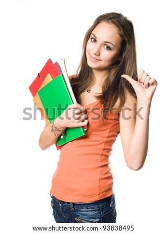 Beautiful young brunette student pointing towards herslef with thumb.