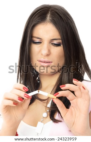 beautiful young brunette woman breaks a cigarette and frowns