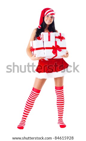 beautiful young brunette woman dressed as Santa with presents in her hands