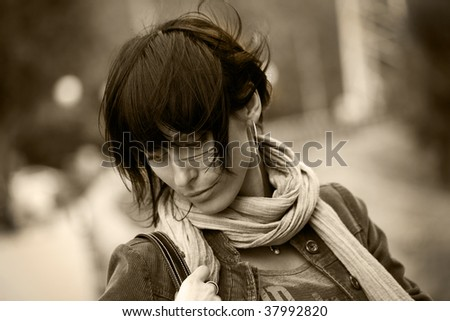 Beautiful young brunette woman having a walk in park , black white