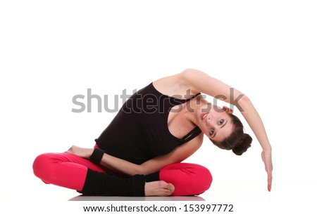 beautiful young brunette woman stretching the muscles of her arms and back, isolated against white background