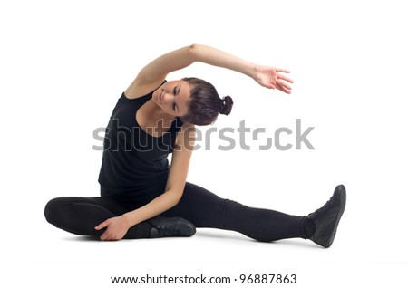 Beautiful young brunette woman stretching the muscles of her arms and back. Isolated against white background