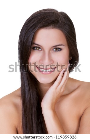 Beautiful young brunette woman with a lovely smile looking directly into the camera