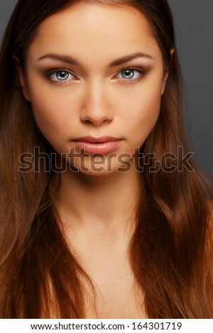 Stock Photo Beautiful young brunette woman with blue eyes