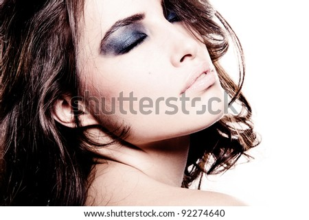 beautiful young brunette woman with strong makeup, eyes closed