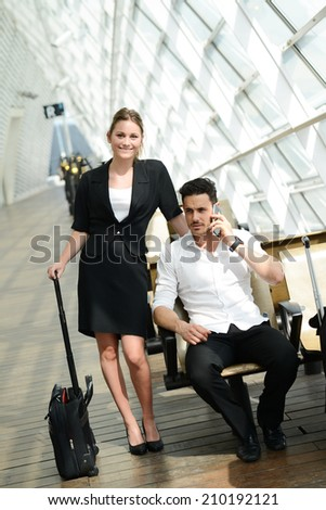 beautiful young business people man and woman waiting in a public transportation station