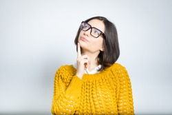 beautiful young business woman dreaming, wearing glasses, isolated photo on background