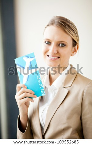 beautiful young businesswoman holding air ticket