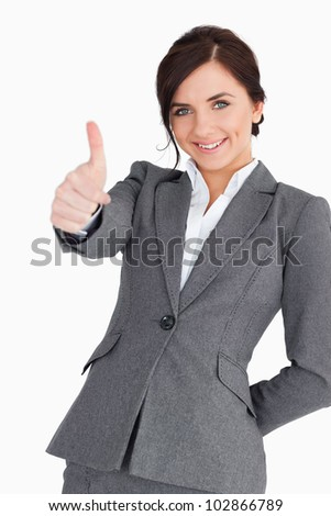 Beautiful young businesswoman the thumb-up against white background
