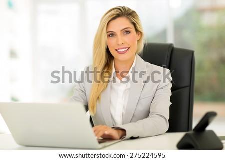 beautiful young businesswoman using computer #275224595