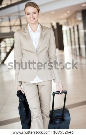 beautiful young businesswoman walking at airport