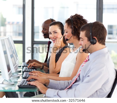 Beautiful young businesswoman working in a call center