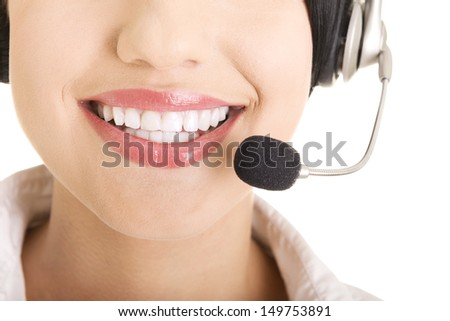 Beautiful young call-center assistant smiling , isolated