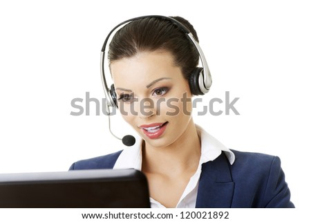 Beautiful young call-center assistant smiling , isolated on white