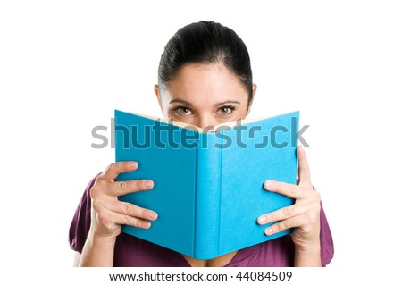 Beautiful young casual woman hiding herself behind a book isolated on white background - stock photo