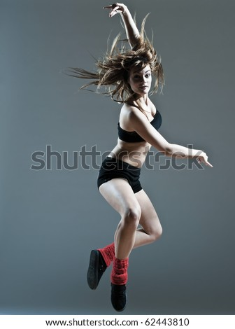young caucasian woman girl dancer ballet break dance leap jump on studio