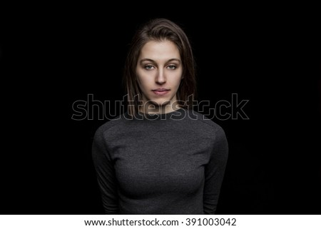 beautiful young caucasian woman portrait on black background #391003042