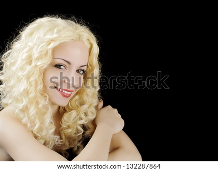 Beautiful young Caucasian woman with curly blond hair, smiling