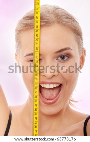 Beautiful young caucasian woman with measuring tape