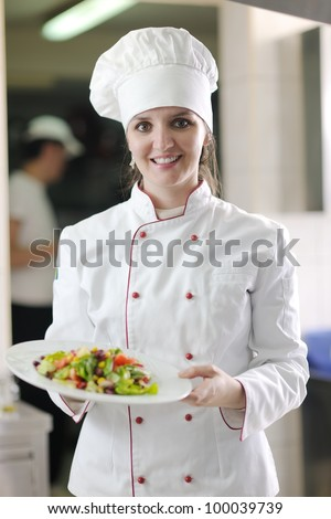 beautiful young chef woman prepare and decorating tasty food in kitchen