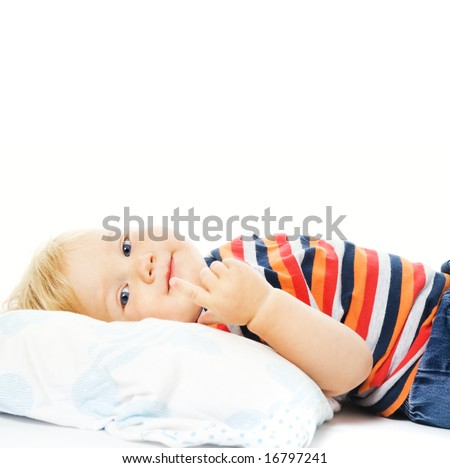 Beautiful young child waking up in the morning. Isolated on white background