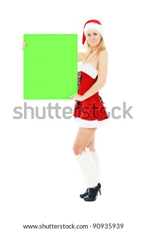 Beautiful young christmas woman in Santa Claus hat holding green blank banner. isolated on white background.