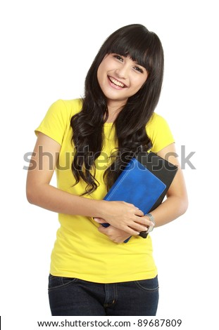 beautiful young college student holding books. isolated on white background
