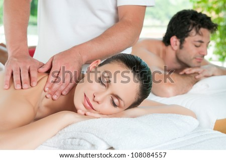 Beautiful young couple enjoy together a massage at spa centre #108084557