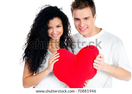 beautiful young couple holding a red heart