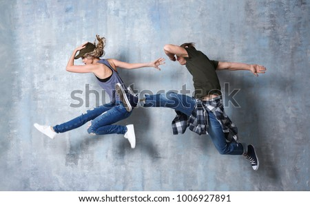 Beautiful young couple in dance studio Stockfoto ©