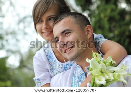 beautiful young couple in embroidered shirts - stock photo