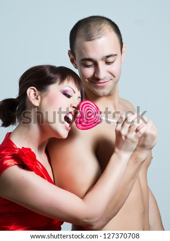 beautiful young couple in love fooled,She reaches for candy