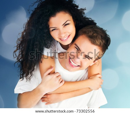 beautiful young couple in love on abstract blue background