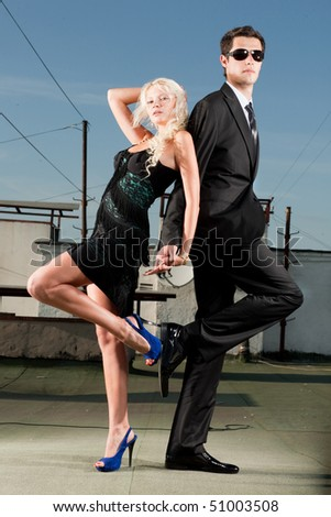 beautiful young couple on the roof