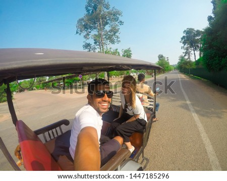 Beautiful young couple selfie on a tuktuk in Siem Reap, Cambodia. On the way to Angkor Wat and temples of the complex. Asia. Southeast Asia.  #1447185296