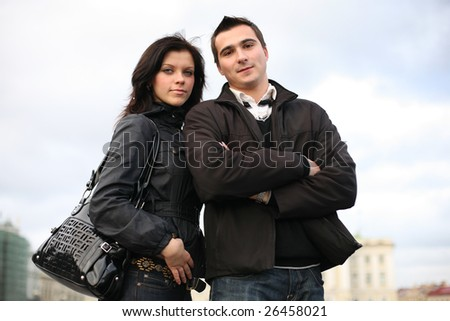 Beautiful young couple together in city