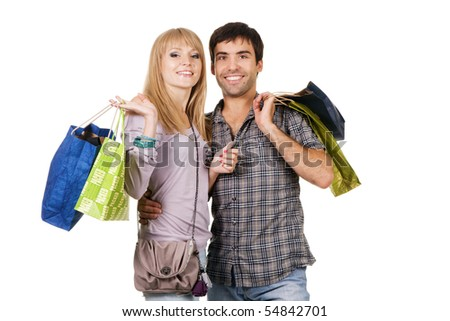Beautiful young couple with shopping bags, isolated on white background
