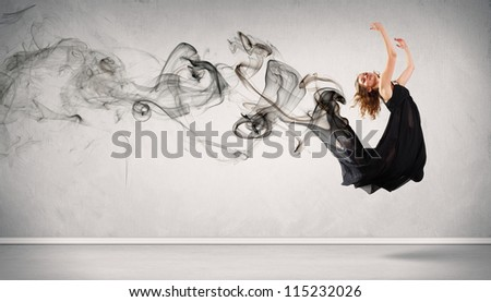 Beautiful young dancer with black smoke curles around her