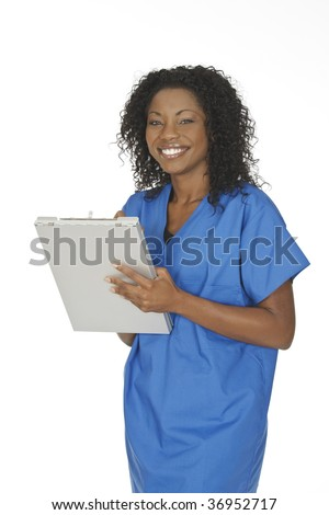 Beautiful young doctor writing on the pad over white background