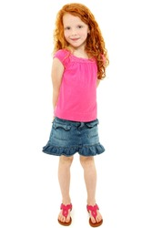 Beautiful young elementary age school girl over white with long curly red hair in summer clothes.