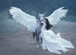 Beautiful, young elf, walking with a unicorn. An unbelievable white dress with long sleeves and a train waving in the wind. Artistic Photography Artistic Photography