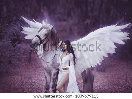 Beautiful, young elf, walking with a unicorn. She is wearing an incredible light, white dress. Art hotography