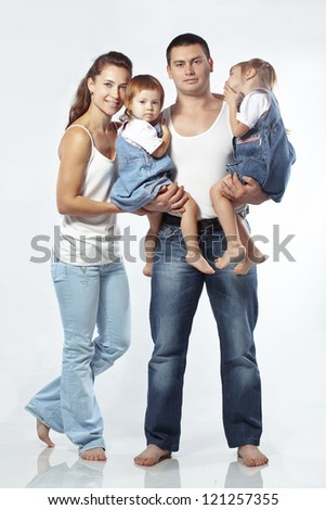 Beautiful young family happy with their kids