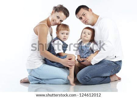 Beautiful young family happy with their kids over white background