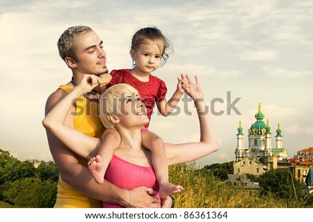 Beautiful young family on background of ancient church.