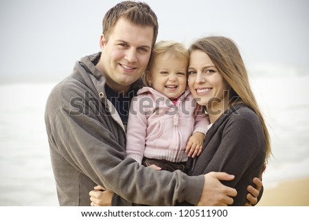 Beautiful Young Family Portrait on the Beach