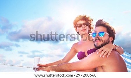 Beautiful young family spending hot summer days on the sailboat, traveling along sea, romantic relationship, enjoying honeymoon